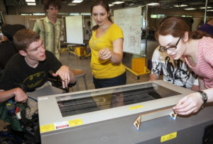 AccessEngineering and DO-IT summer students explore the CoMotion makerspace.
