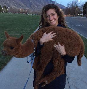 Cassandra (aka CJ) holds a llama, or maybe it is an alpaca.