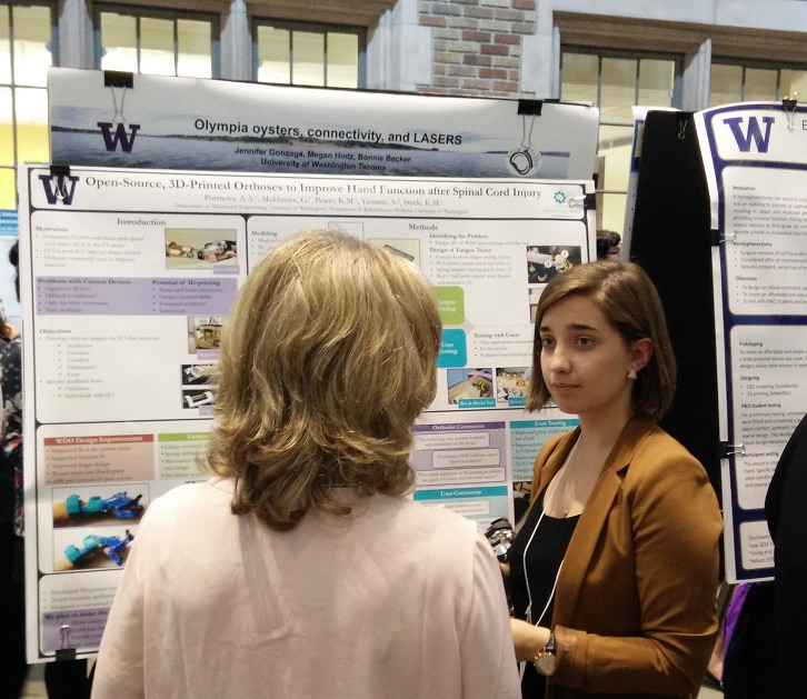 Sasha Portnova, a member of our research team, fields questions from an interested member of the community about her wrist-driven, wrist-hand orthosis.