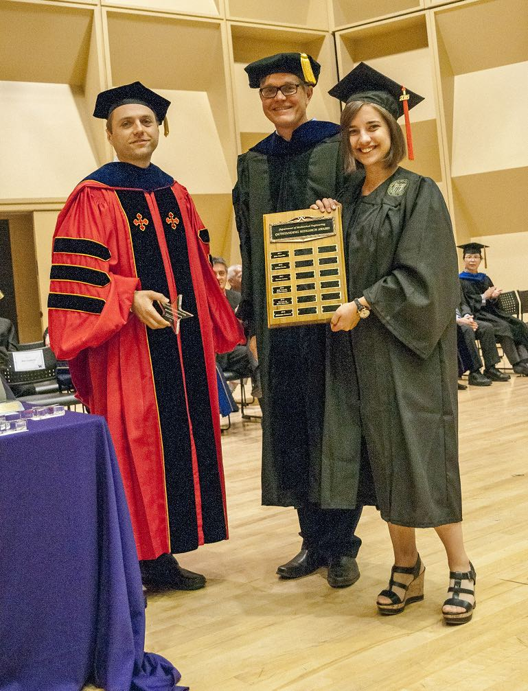 Nate Sniadecki, Per Reinhall, and awardee, Sasha Portnova pose with the award placard at graduation ceremony.