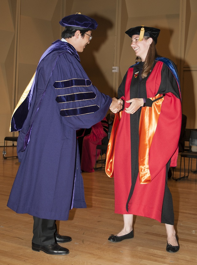 Dr. Kat Steele shakes the hand of her mentee, Dr. Hwan Choi
