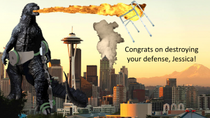 "A silly congratulations graphic made by the lab depicting the fictional Godzilla stomping through downtown Seattle, while wearing PlayGait, the pediatric exoskeleton Jessica worked on for her masters. Test within the photo reads, ""Congrats on destroying your defense, Jessica!"""
