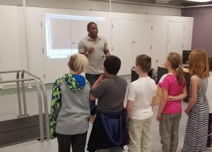 Darrin shows a group of fourth graders the basics of human motion analysis.