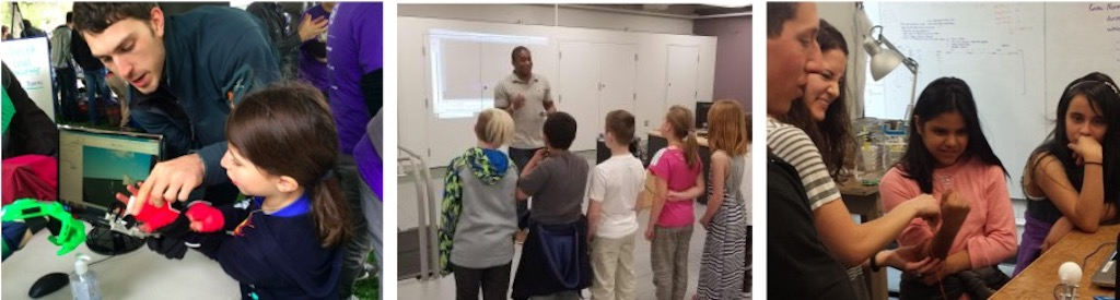 Ben shows a student at Discovery Days 3D-printed orthoses. Darrin teaches a group of fourth graders about motion analysis. Keshia and Michael show students how to use their muscles to control devices.