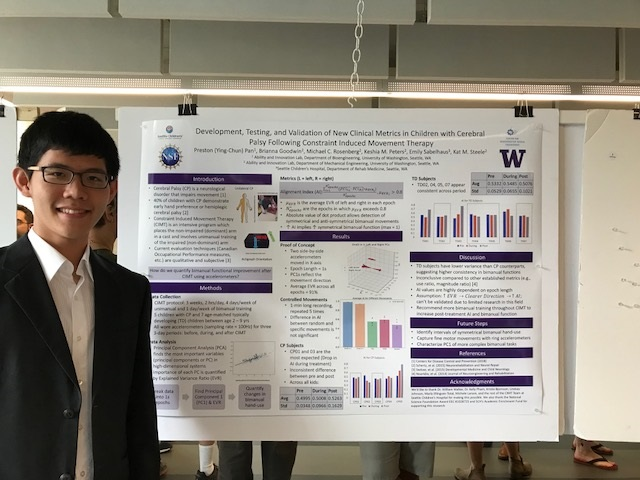 Preston Pan, in a white collared shirt and blazer, stands in front of his scientific poster evaluated a proposed motion tracking algorithm for bimanual movement.