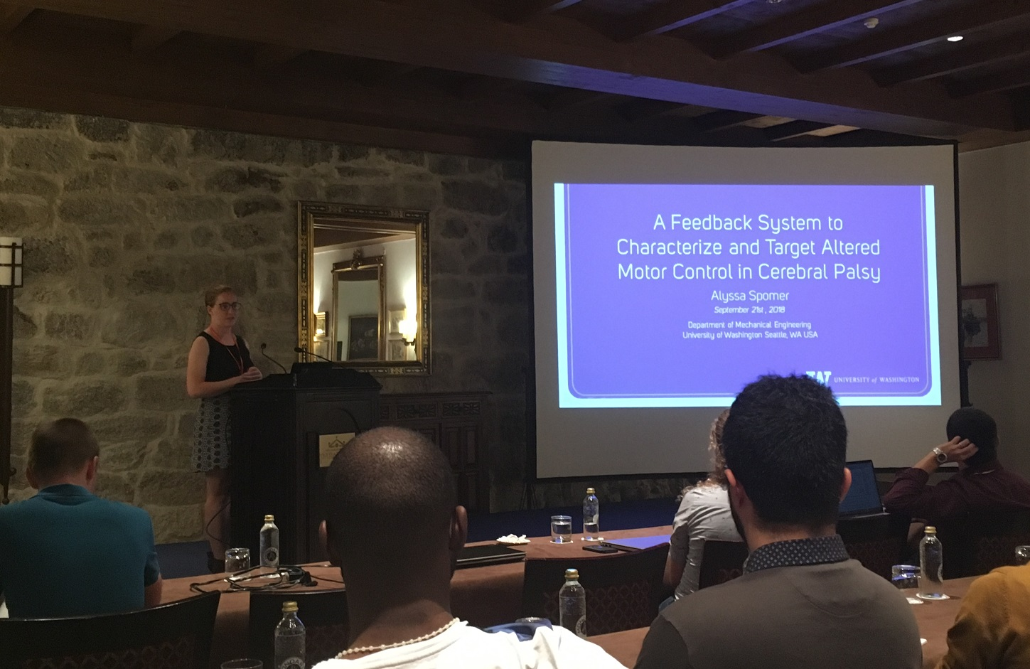 "Alyssa at podium presenting ""A Feedback System to Characterize and Target Altered Motor Control in Cerebral Palsy""."