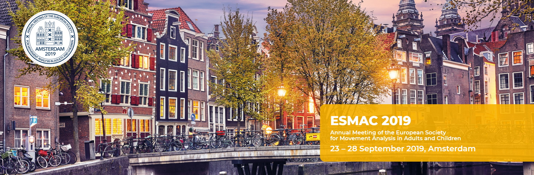 Logo for the 2019 ESMAC meeting overlaid on a classic Amsterdam scene, bikes lined up on a bridge over a canal with historic buildings in the background.